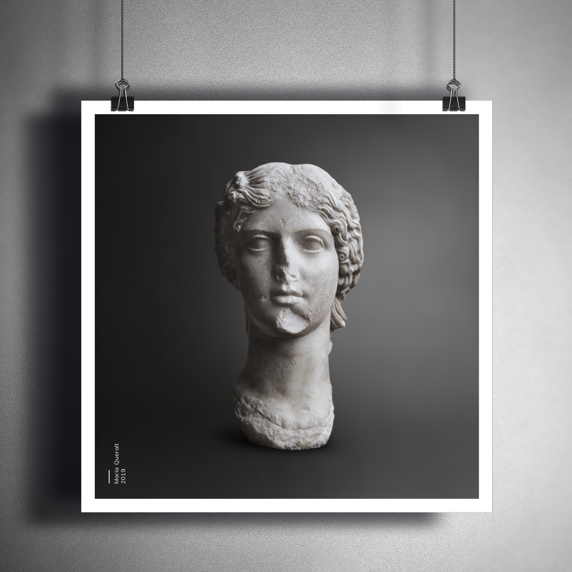 Framed photo on wall of the Sculpture of Agrippina the Elder, mother of Roman Emperor Caligula, Louvre Museum, Paris. Part of the Ancient Influencers Photography series by Maria Queralt. Photography and retouche by Maria Queralt
