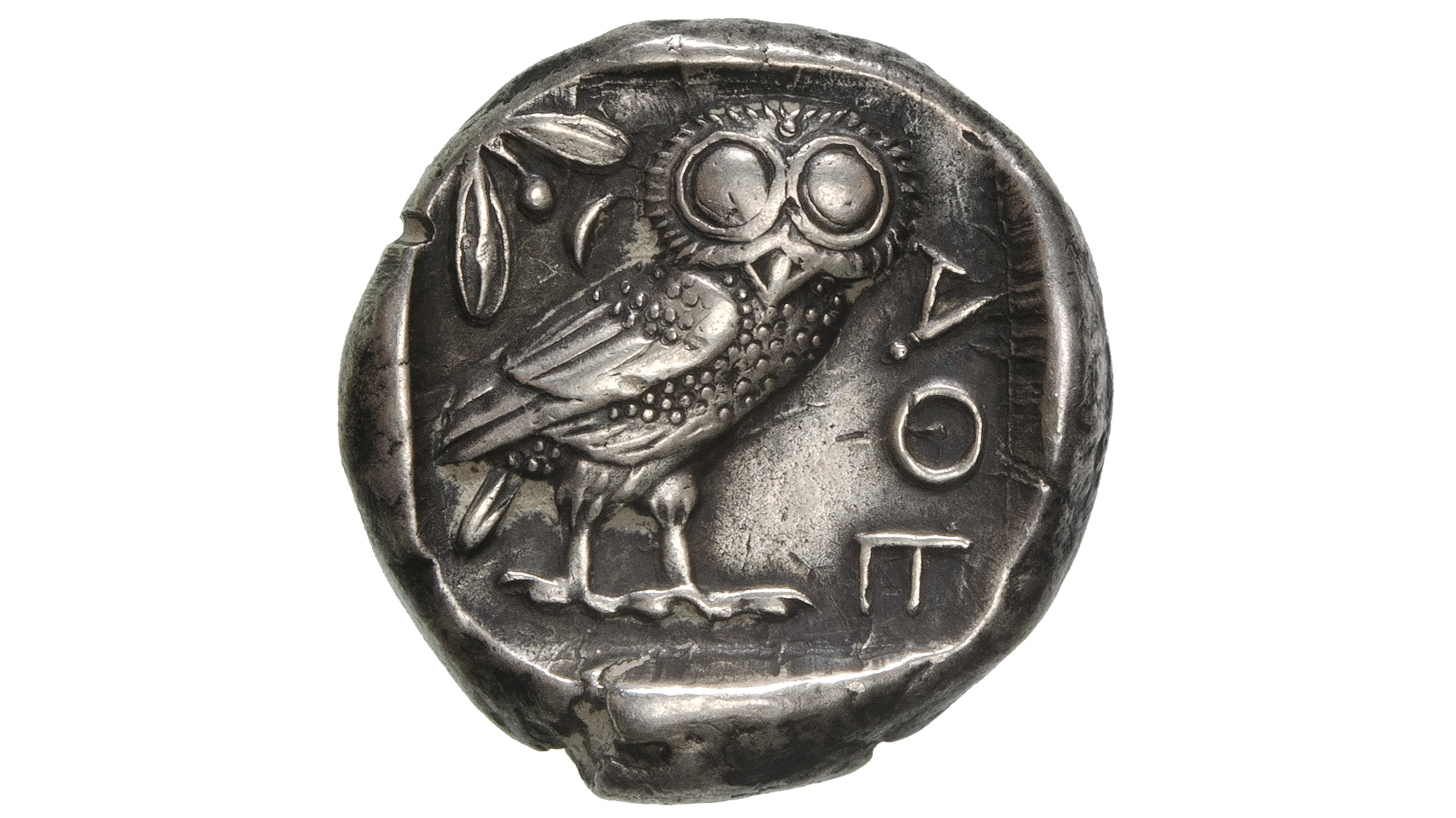 Photography of Greek Coin in silver from Athens classical period with the owl of Athena AOE, photographed for Morton and Eden in association with Sotheby's sold in auction in London Photography and retouch by Maria Queralt