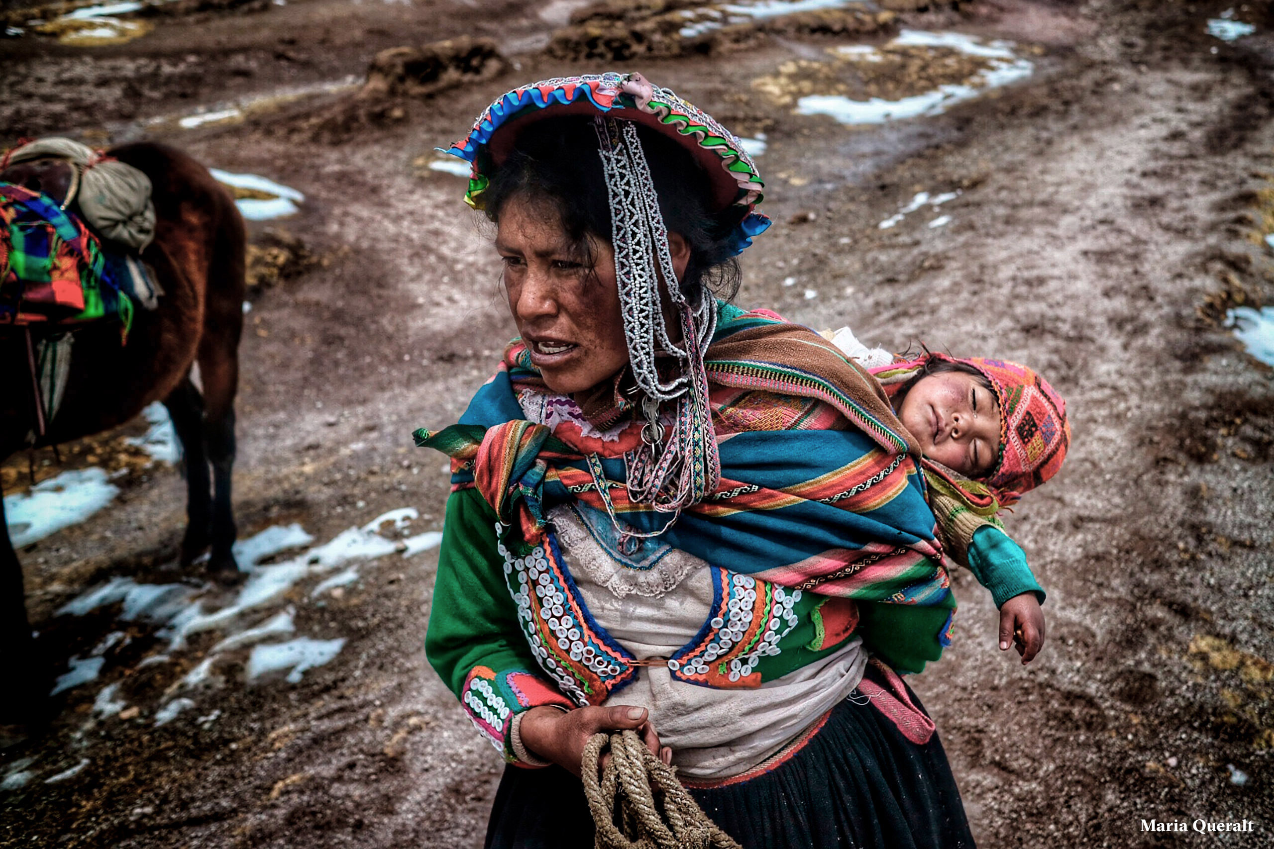 Portrait of a Cholita carrying her child climbing the Seven Colors Mountain in Peru. Photography and retouch by Maria Queralt