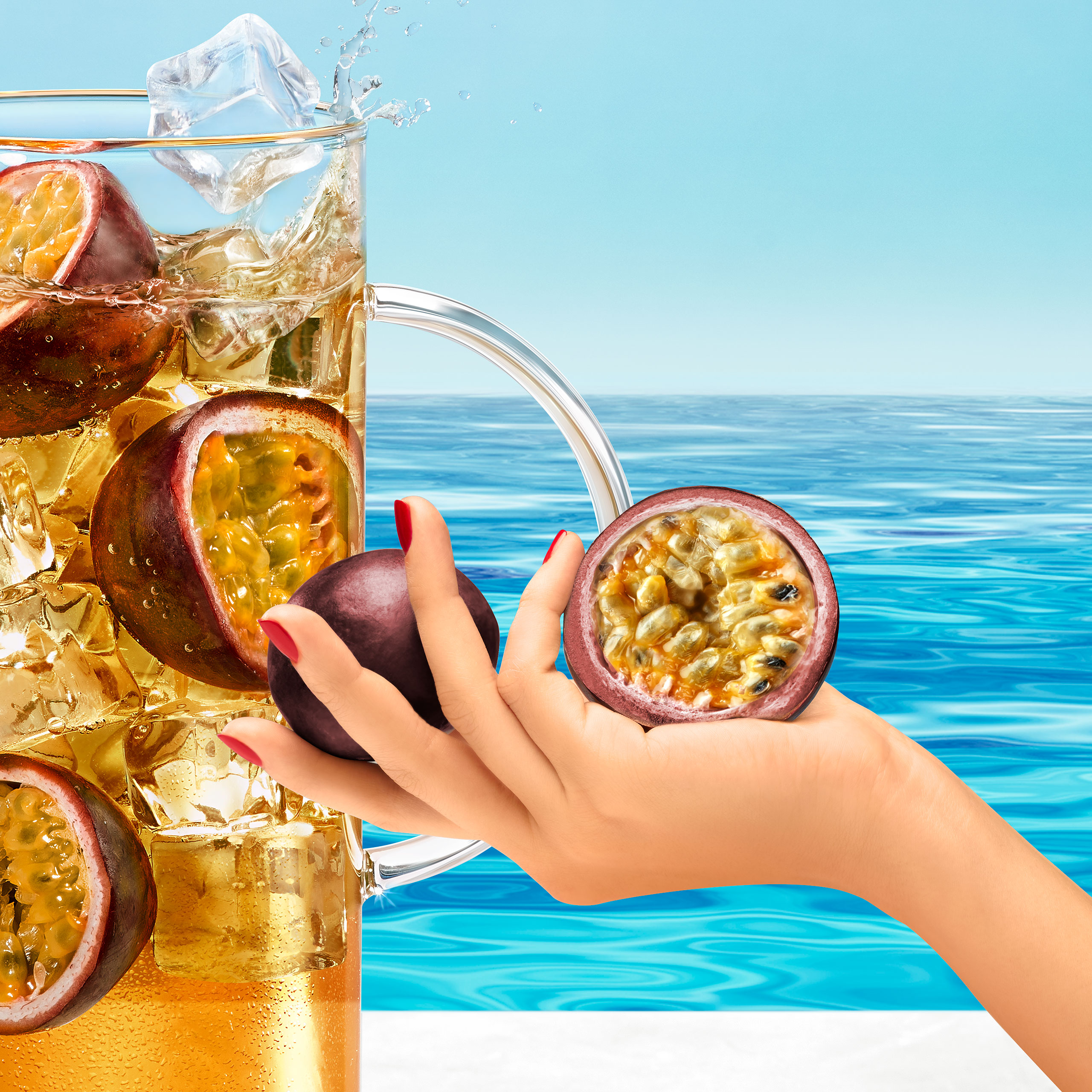 Commercial photography for Kusmi Tea showing how to prepare Iced tea. With a jar filled with iced tea, passion fruits and ice cubes at the swimming pool. Four arms are preparing the tea with the ice cubes, the tea bag and the passion fruits. Photograph retouched by Maria Queralt